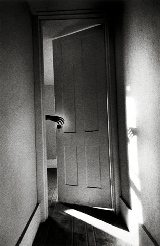 Hand Through Door